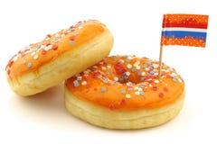 De sinaasappel donuts met rood, wit en blauw bestrooit Stock Afbeelding
