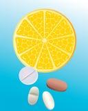 De sinaasappel en de tabletten van de besnoeiing. Stock Afbeelding