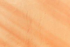 De sinaasappel gepleisterde achtergrond van de muurtextuur Royalty-vrije Stock Foto's