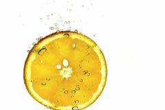 De sinaasappel van de plak en bubles Stock Foto's