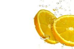 De sinaasappel van de Plak van de plons Stock Afbeeldingen