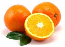 De sinaasappelen en doorbladert stock fotografie