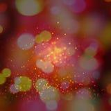 De skupiający się okrąg błyskotliwości bokeh zaświeca abstrakcjonistycznego tło w brown czerwonych kolor żółty menchiach Fotografia Royalty Free