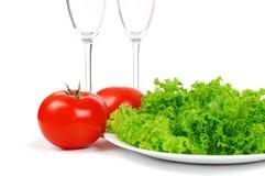 De sla en de tomaat van bladeren Stock Fotografie