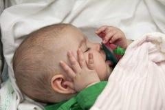 De slaap van de baby stock foto