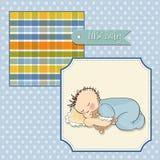 de slaap van de babyjongen met zijn teddybeerstuk speelgoed Stock Fotografie