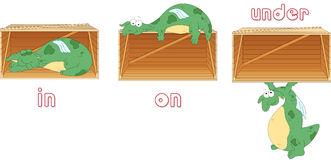 De slaap van de beeldverhaaldraak in een doos, ligt op een doos en bevindt zich onder a vector illustratie