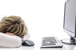 De slaap van de mens bij zijn bureau Stock Foto's