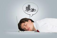De slaap van de mens op laptop Royalty-vrije Stock Foto