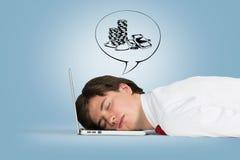 De slaap van de mens op laptop Stock Fotografie