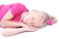 De slaap van het meisje op wit Stock Foto's