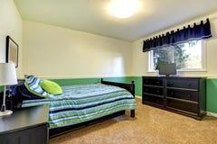 De Slaapkamer van de tiener met zwarte en groen. Royalty-vrije Stock Foto's