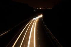 De sleep van autolichten Stock Foto's