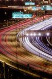 De Sleep van het verkeerslicht op een Weg stock foto
