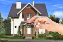 De sleutel en het huis stock foto