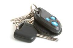 De sleutel en het huissleutels van de auto Stock Foto's