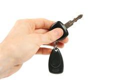 De sleutel van de auto in de hand Stock Afbeelding