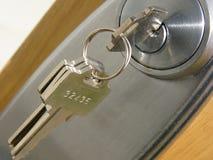 De sleutel van de deur Stock Foto's