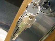 De sleutel van de deur Stock Afbeeldingen