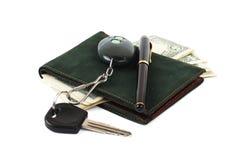 De sleutel van de portefeuille, van de pen en van de auto royalty-vrije stock foto