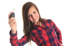 De sleutel van de tienerholding voor een witte achtergrond royalty-vrije stock foto