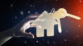 De sleutel van de zakenmanholding met huissleutelring in zijn 3D hand geeft terug Royalty-vrije Stock Fotografie