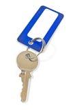 De sleutel van het huis met blauwe markering Stock Foto