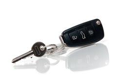 De sleutels van de auto en van het huis Stock Afbeelding