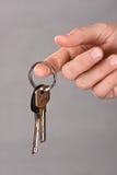 De sleutels van de handholding, close-up stock fotografie