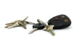 De sleutels van het huis en autosleutels Stock Afbeeldingen