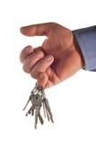 De sleutels zijn in een hand Stock Afbeelding