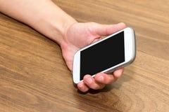 De Slimme Telefoon van de Holding van de hand Royalty-vrije Stock Afbeelding