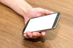 De Slimme Telefoon van de Holding van de hand Stock Foto's