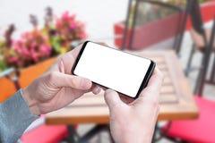 De slimme telefoon van de mensengreep in horizontale positie met het geïsoleerde scherm voor model, app, video, de presentatie va Royalty-vrije Stock Fotografie