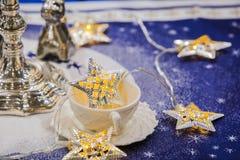 De slinger van het Kerstmisdecor in de vorm van een ster Stock Afbeeldingen