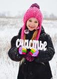 De sneeuw van de meisjeswinter rond royalty-vrije stock foto