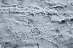 De sneeuwbrijvoetafdrukken van de sneeuw Stock Afbeelding