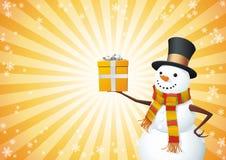 De sneeuwman houdt de gift Stock Fotografie