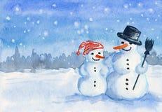 De sneeuwman van de familie Stock Afbeeldingen