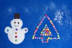 De Sneeuwman van de suiker en de Boom van het Suikergoed Stock Foto