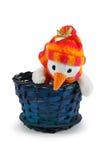 De sneeuwman van het stuk speelgoed in blauwe mand Royalty-vrije Stock Foto