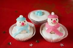 De sneeuwman van Kerstmis cupcake Stock Afbeeldingen