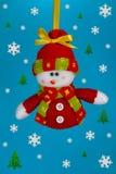De sneeuwman witn sneeuwvlokken en Kerstbomen van Fanny. Stock Afbeeldingen