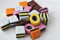 De snoepjes van het zoethout op een witte achtergrond Stock Fotografie