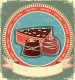 De snoepjesetiket van de chocolade dat op oude document textuur wordt geplaatst Stock Afbeeldingen