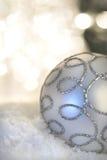 De snuisterij van Kerstmis met licht op achtergrond Stock Foto's