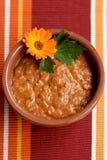 De soep van de tomaat bij een lijst Royalty-vrije Stock Foto