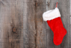 De sok van Kerstmis op hout Stock Foto's
