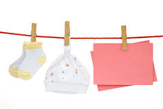De sokken van de baby en GLB en lege nota royalty-vrije stock afbeelding
