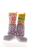 De sokken van kinderen met Euro bankbiljetten Royalty-vrije Stock Foto